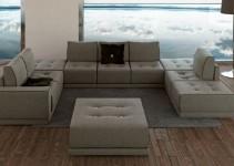 Elegante sofá con botones y ribeteado