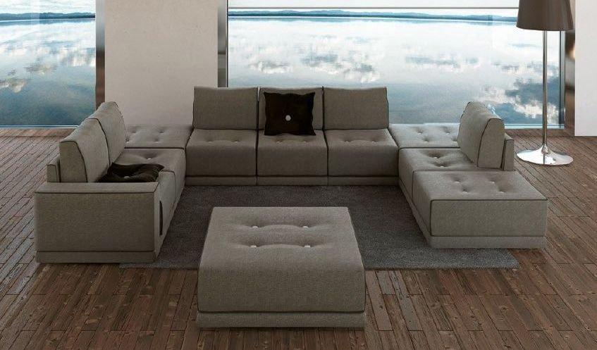 elegante sof con botones y ribeteado