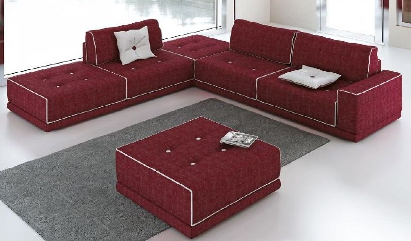 Sofá tapizado modular con botones